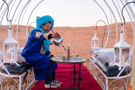 Our guy, Hakim, serving Moroccan tea in our Erg Chebbi Luxury Desert Camp Merzouga.jpg